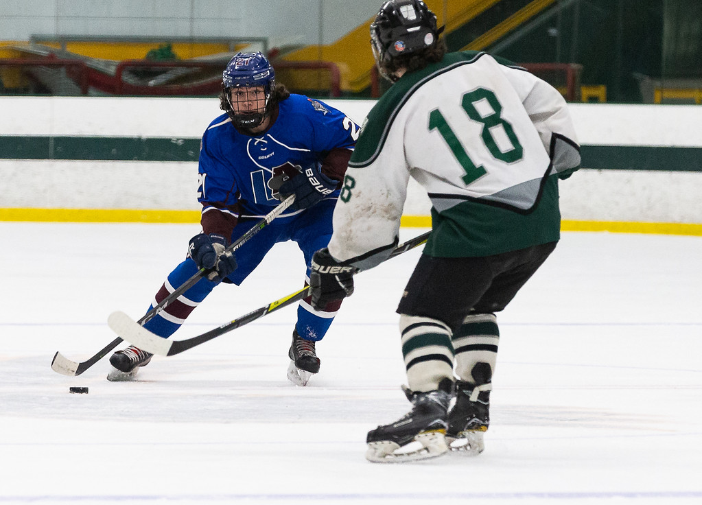 . Lunenburg/Ayer Shirley\'s Nathan Handy attempts to move the puck past a Grafton defender during a Central Mass. Division 3A semifinal boys\' hockey game at the Wallace Civic Center on Tuesday, March 5, 2019. SENTINEL & ENTERPRISE / GARY FOURNIER