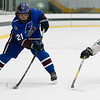 Nathan Handy fires a wrist shot against a Grafton defender.<br /> SENTINEL & ENTERPRISE / GARY FOURNIER