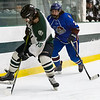 Nathan Handy  battles for the puck against a Grafton defender.<br /> SENTINEL & ENTERPRISE / GARY FOURNIER