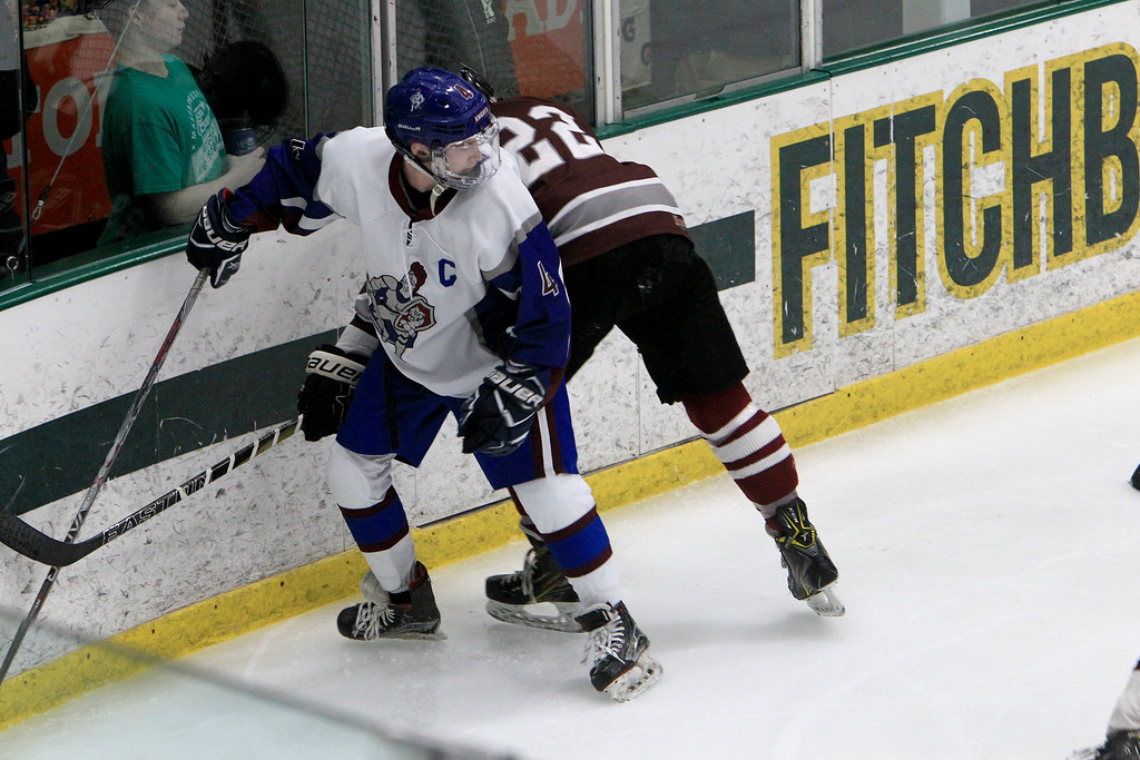 . Lunenburg\'s Sean Simpson is checked by a Northbridge player. SENTINEL & ENTERPRISE / VINCENT APOLLONIO