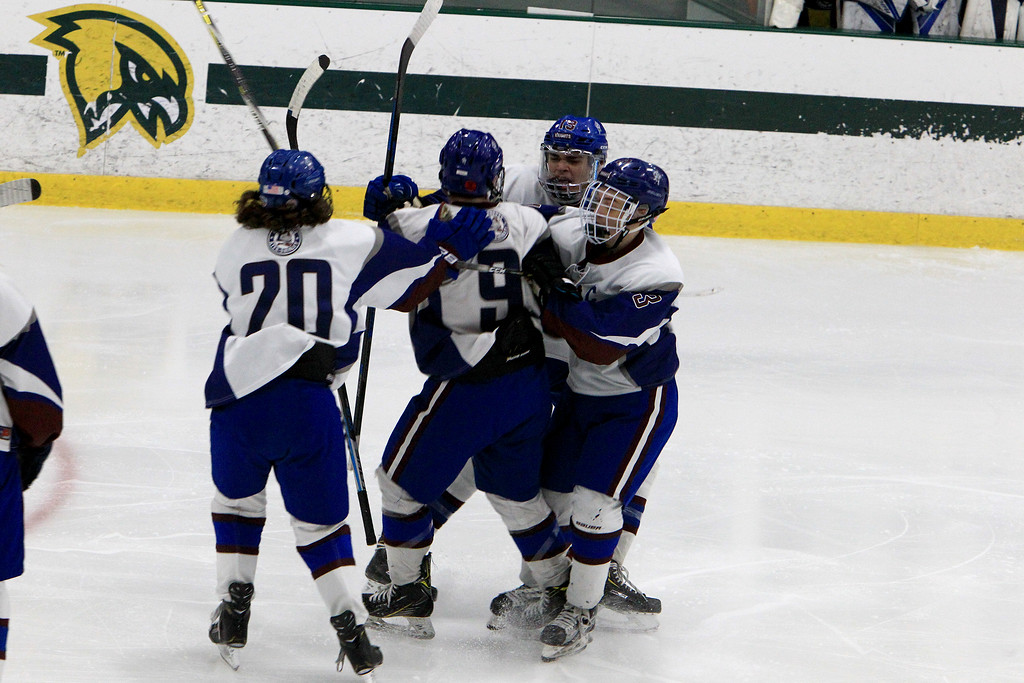 . Lunenburg players celebrate after a goal by Connor . SENTINEL & ENTERPRISE / VINCENT APOLLONIO