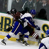 Lunenburg/Ayer Shirley's Connor Viviano checks a Northbridge player into the boards during the Central Mass. Division 3A championship game at the Wallace Civic Center in Fitchburg on Sunday, March 10, 2019. Northbridge won, 2-1 in overtime.<br /> SENTINEL & ENTERPRISE / VINCENT APOLLONIO