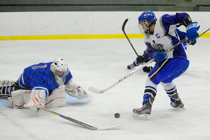 Lunenburg/Ayer-Shirley's Tom Wagner attack on net gets saved by Hopedale/Millis goalie CJ Golash during Monday's game.<br /> SENTINEL & ENTERPRISE / BRETT CRAWFORD