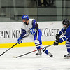 Lunenburg/Ayer-Shirley's Ryan Young skates up ice as Hopedale/Millis' Cam Wenzel defends, Monday.<br /> SENTINEL & ENTERPRISE / BRETT CRAWFORD