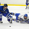 Hopedale's Tyler Reynolds (left) defends as Lunenburg/Ayer-Shirley's Chad Saulnier hits the puck up ice during Monday's game.<br /> SENTINEL & ENTERPRISE / BRETT CRAWFORD