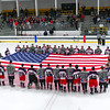Groton-Dunstable and North Middlesex players gather at center ice and waive the American flag before the start of Saturday night's Sixth-annual military night game. Nashoba Valley Voice/Ed Niser