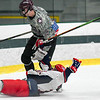 Groton-Dunstable's Andrew Berube knocks down a North Middlesex player during Saturday's game. Nashoba Valley Voice/Ed Niser