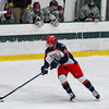 North Middlesex's Sean Lynch controls the puck. Nashoba Valley Voice/Ed Niser