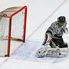 Groton-Dunstable's Ben McEvoy makes a pad save during Saturday's loss to North Middlesex. Nashoba Valley Voice/Ed Niser