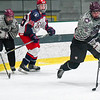 Groton-Dusntable's Liam McDonough skates with the puck during Saturday night's loss to North Middlesex. Nashoba Valley Voice/Ed Niser