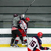 Groton-Dunstable and North Middlesex battles along the boards. Nashoba Valley Voice/Ed Niser