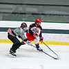 North Middlesex's Nick White controls the puck as he is defended by Deaglan Garside. Nashoba Valley Voice/Ed Niser