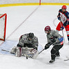 Groton-Dunstable's Ben McEvoy makes a stick save during Saturday night's loss to North Middlesex. Nashoba Valley Voice/Ed Niser