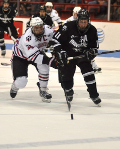 022313, Boston, MA - Northeastern's Vinny Saponari (74) tries to put the puck past Providence's Tim Schaller (11) during the first period of Saturday night's game. Herald photo by Ryan Hutton