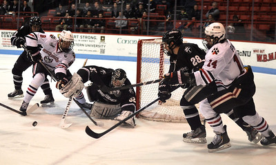 022313, Boston, MA - Players converge on the net as Northeastern's Adam Reid (8) is denied by Providence goaltender Jon Gillies (32) during the second period of Saturday night's game. Also pictured are Northeastern's Braden Pimm (14) and Providence's Steven Shamanski (28) and John Gilmour (3). Herald photo by Ryan Hutton