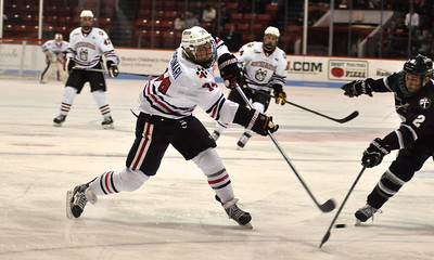 022313, Boston, MA - Northeastern's Vinny Saponari (74) fires the puck  past Providence's Kevin Hart (2) during the first period of Saturday night's game. Herald photo by Ryan Hutton