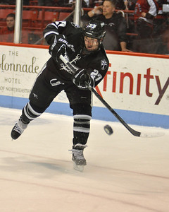 022313, Boston, MA -  Providence College's Alex Velischek (27) fires the puck down the ice during the first period of Saturday night's game against Northeastern University. Herald photo by Ryan Hutton