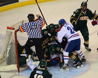 101212, Lowell, MA - A pile of players and officals form around Vermont's net after a hit on Vermont goalie Brody Hoffman with just under seven minutes to go in the first period of Friday night's game. Herald photo by Ryan Hutton.