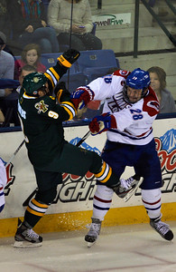 101212, Lowell, MA - Lowell's Jake Suter throws a shove at Vermont's Kyle Reynolds during the first period of Friday night's game. Herald photo by Ryan Hutton.