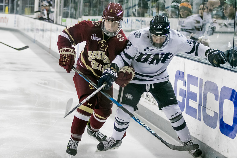 UNH's Ara Nazarian, right, slips by the defense of BC's Jesper Mattila, left, during Friday night's Hockey East game at the Whittemore Center Arena in Durham.  Photo by Scott Patterson/Fosters.com