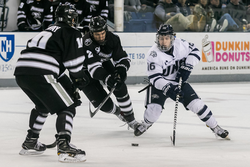 UNH's Tyler Kelleher, right, weaves his way through Providence defenders during Saturday's game at the Whittemore Center Arena in Durham. Photo by Scott Patterson/Fosters.com