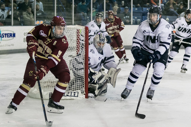 UNH's Dylan Chanter, right, defends against BC's Ryan Fitzgerald, left, during Friday night's Hockey East game at the Whittemore Center Arena in Durham.  Photo by Scott Patterson/Fosters.com