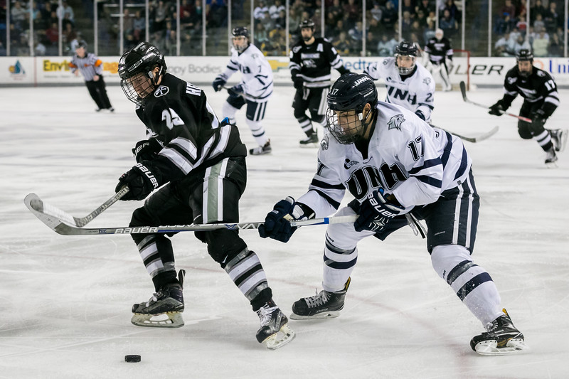 UNH's Marcus Vela, right, defends against Providence's Robbie Hennessey, left, during Saturday's game at the Whittemore Center Arena in Durham. Photo by Scott Patterson/Fosters.com