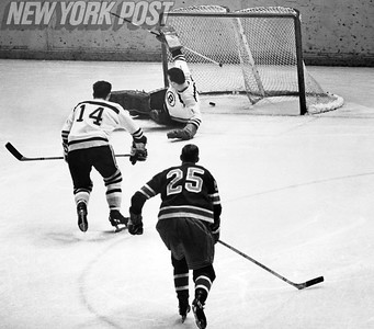 Rangers' Orland Kurtenbach scores a goal on Bruins Ed Johnston. 1966