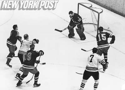 Chicago Blackhawks Bobby Hull scores on Rangers Ed Giacomin. 1966