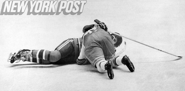 Rangers Brad Park and Canadiens Serge Savard tie up. 1974