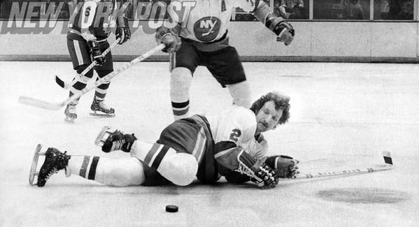 Islanders Gerry Hart blocks Maple Leafs Norm Ullman's Shots. 1974