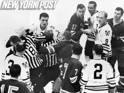 Phil Esposito rushes at Reg Fleming amidst the chaos. 1966
