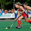 Kathleen Sharkey from the US pursued by Naomi van As from the Netherlands during a field hockey game on the 10th of June 2016 in Hilversum the Netherlands. The US won the game 3-2.