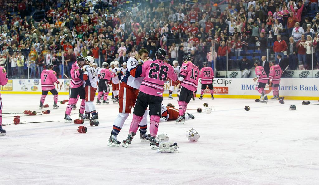 IMAGE: http://www.reicherstudios.com/Sports/HockeyPhotos/HogsVGrifs-0119-13/i-6W8h9Qq/0/XL/IMG_2591-XL.jpg