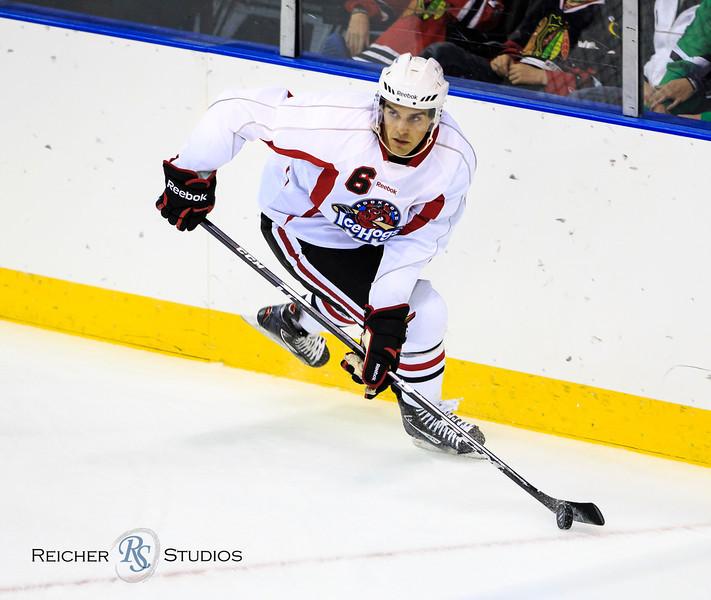 IMAGE: http://www.reicherstudios.com/Sports/HockeyPhotos/IceHogs-100412/i-ftjNRMf/0/L/IMG4172-L.jpg