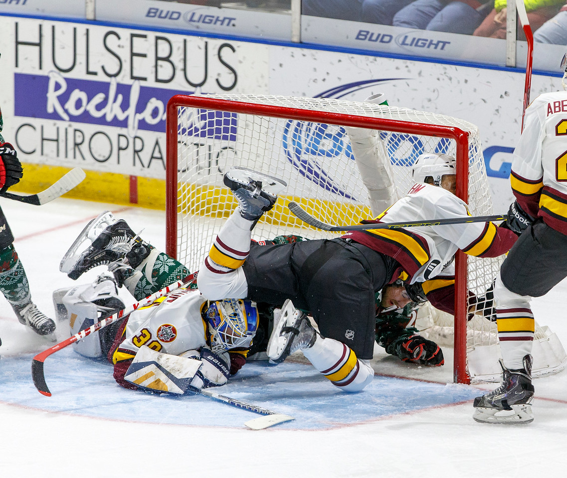 IMAGE: http://www.reicherstudios.com/Sports/HockeyPhotos/IceHogs-20152016/11-27-15-IceHogs-vs-Wolves/i-2btfcBW/0/X2/CC6Q0489_4151-X2.jpg