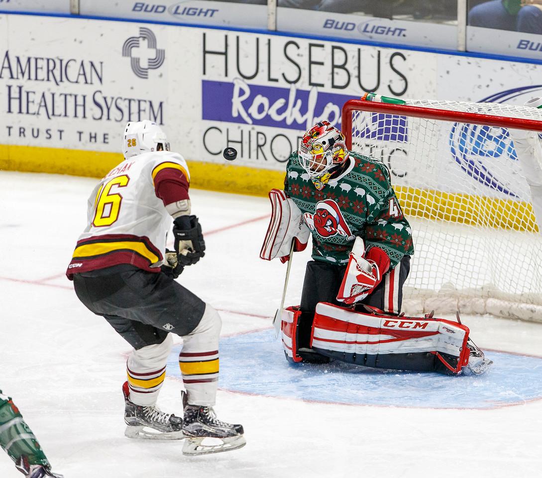 IMAGE: http://www.reicherstudios.com/Sports/HockeyPhotos/IceHogs-20152016/11-27-15-IceHogs-vs-Wolves/i-Lw364XX/0/X2/CC6Q0562_4226-X2.jpg