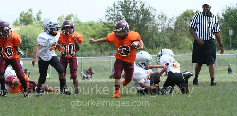 Left in the grass! #3 doing a quarterback run that left two defenders running into each other. Its football time again.