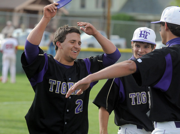 Rob McCandlsih,  Holy Family is congratulated by teammates after scoring a runs against Faith Christian during the state 3A championship game at Jackson Field in Greeley on Saturday.<br /> May 28, 2011<br /> staff photo/David R. Jennings