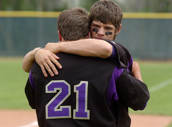 Holy Family's Rayn Silva, right, and Rob McCandlish comfort each other after loosing to  Faith Christian in the state 3A championship game at Jackson Field in Greeley on Saturday.<br /> May 28, 2011<br /> staff photo/David R. Jennings
