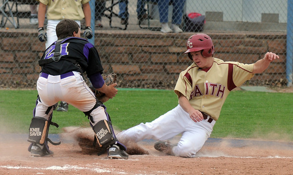 Holy Family's catcher Rob McCandlish tags out Stephen Galambos, Faith Christian during the state 3A championship game at Jackson Field in Greeley on Saturday.<br /> May 28, 2011<br /> staff photo/David R. Jennings