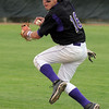 Holy Family's second baseman Jarred DeHerrera prepares to throw after catching a ground ball hit by Faith Christian during the state 3A championship game at Jackson Field in Greeley on Saturday.<br /> May 28, 2011<br /> staff photo/David R. Jennings