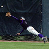 Holy Family's Kyle Munoz dives to catch a hit by Faith Christian in left field for an out during the state 3A championship game at Jackson Field in Greeley on Saturday.<br /> May 28, 2011<br /> staff photo/David R. Jennings