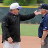 Holy Family's head coach Marc Cowell argues with the first base umpire after a controversial play at first base during the state 3A championship game at Jackson Field in Greeley on Saturday.<br /> <br /> <br /> May 28, 2011<br /> staff photo/David R. Jennings