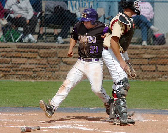 Rob McCandlish, Holy Family, scores a run past catcher Ben Rice, Faith Christian during the state 3A championship game at Jackson Field in Greeley on Saturday.<br /> May 28, 2011<br /> staff photo/David R. Jennings