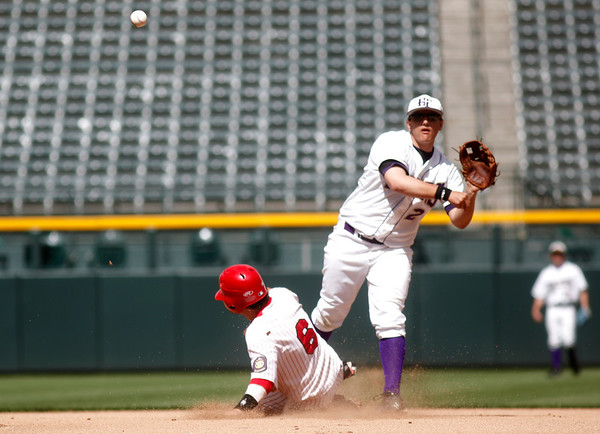 """Holy Family's, Joe Walls,#2, makes the play to get Eaton's, Weston Hager, #6, out at second base on Saturday, March, 31. 2012. Denver. <br /> <br />  For more photos of the game visit  <a href=""""http://www.dailycamera.com"""">http://www.dailycamera.com</a><br /> Photo by Derek Broussard"""