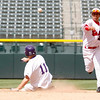 """Holy Family's Devlin Granberg,#11, is called out at second base as Eaton's, Jacob Mondragon, #2, throws the ball too first base on Saturday, March, 31. 2012. Denver. <br /> <br />  For more photos of the game visit  <a href=""""http://www.dailycamera.com"""">http://www.dailycamera.com</a><br /> Photo by Derek Broussard"""