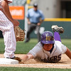 """Holy Family's, Jacob Tinnon,#13, makes it back to first base before Eaton's, Keenan Hall, #8, can tag him out on Saturday, March, 31. 2012. Denver. <br /> <br />  For more photos of the game visit  <a href=""""http://www.dailycamera.com"""">http://www.dailycamera.com</a><br /> Photo by Derek Broussard"""