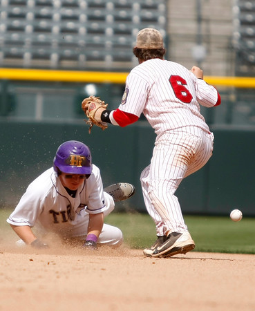 "Holy Family's Jay Elliot,#10, slides past Eaton's, Weston Hager, #6, into second base during the first inning of the game on Saturday, March, 31. 2012. Denver. <br /> <br />  For more photos of the game visit  <a href=""http://www.dailycamera.com"">http://www.dailycamera.com</a><br /> Photo by Derek Broussard"