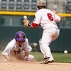 """Holy Family's Jay Elliot,#10, slides past Eaton's, Weston Hager, #6, into second base during the first inning of the game on Saturday, March, 31. 2012. Denver. <br /> <br />  For more photos of the game visit  <a href=""""http://www.dailycamera.com"""">http://www.dailycamera.com</a><br /> Photo by Derek Broussard"""